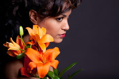 Pretty Woman with Lily Flowers Royalty Free Stock Image