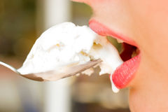 Pretty woman lips with icecream in the spoon Royalty Free Stock Photos