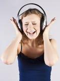 Pretty woman listening, and enjoying music Royalty Free Stock Photos