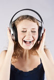 Pretty woman listening, and enjoying music Stock Images