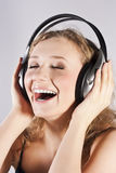 Pretty woman listening, and enjoying music Stock Photos