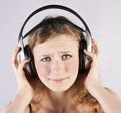 Pretty woman listening, and enjoying music Royalty Free Stock Image