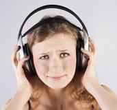 Pretty woman listening, and enjoying music Royalty Free Stock Image