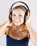 Pretty woman listening, and enjoying music Stock Photos