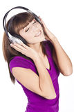 Pretty woman listening, and enjoying music Stock Photography