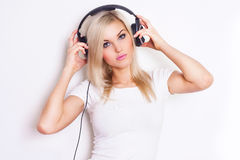 Pretty woman listening and enjoying music in headphones. Stock Photos