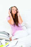 Pretty woman listening music in headphones Royalty Free Stock Images
