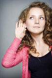 Pretty woman listening to gossip Royalty Free Stock Photos