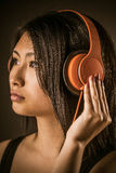 Pretty woman listening to her music on headphones Stock Images