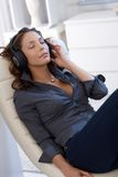 Pretty woman listening to music Royalty Free Stock Photos
