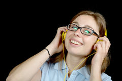 Pretty woman listening to music with a headphone Royalty Free Stock Image