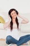 Pretty woman listening to music with headphones Royalty Free Stock Photo