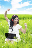 Pretty woman listens to music outdoor stock photography