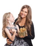 Pretty woman and little girl with a wrapped present Royalty Free Stock Images