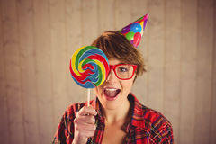 Pretty woman with lollipop and hat party stock images