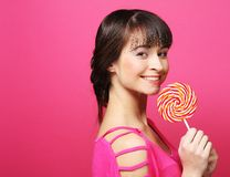 Pretty woman with lollipop Royalty Free Stock Images