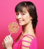 Pretty woman with lollipop Stock Image
