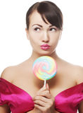 Pretty woman with lollipop Stock Images