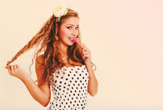 Pretty woman with lollipop in retro style Royalty Free Stock Photo