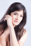 Pretty woman with long  brown hair Royalty Free Stock Photos