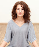 Pretty woman with long curly hair looking at camera Stock Photos