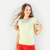 Pretty woman with long hair. Pretty smiling woman pointing at herself Royalty Free Stock Images