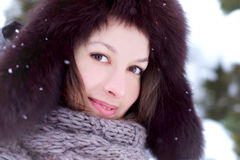 Pretty woman look in winter with snow Royalty Free Stock Image