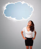 Pretty woman looking abstract cloud copy space Royalty Free Stock Image