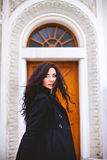Pretty woman looking back front of the door Royalty Free Stock Photo