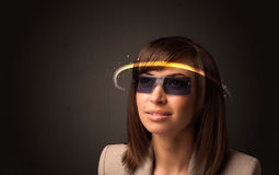 Pretty woman looking with futuristic high tech glasses Royalty Free Stock Images