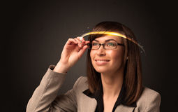 Pretty woman looking with futuristic high tech glasses Royalty Free Stock Photography