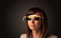 Pretty woman looking with futuristic high tech glasses Royalty Free Stock Image
