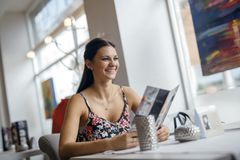 Pretty women looking at menu in restaurant Stock Images