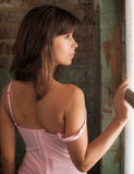 Pretty Woman Looking Out Window Royalty Free Stock Photography