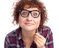 Pretty woman looking over glasses Stock Photo
