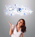 Pretty woman looking social network icons in abstract cloud Stock Photo