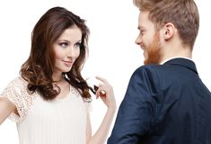 Pretty woman looks slily at her boyfriend Royalty Free Stock Image
