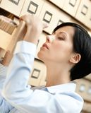 Pretty woman looks for something in card catalog Royalty Free Stock Photography