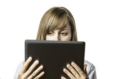 Pretty woman looks on tablet computer Stock Photos