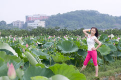 Pretty woman in lotu fields Stock Images