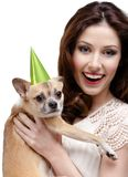 Pretty woman loves a straw-colored small dog Stock Image