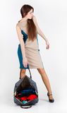 A pretty woman with luggage Royalty Free Stock Photography