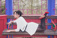 Pretty woman lying on a bench Royalty Free Stock Images