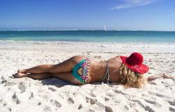 Pretty woman lying on the caribbean beach Royalty Free Stock Images