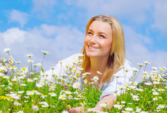 Pretty woman on daisy field Stock Photography
