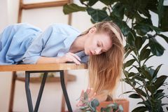 Pretty woman lying down at home royalty free stock images