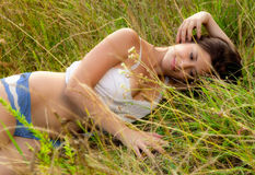 Pretty Woman Lying in Field Stock Photography
