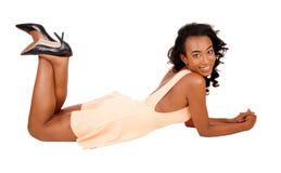 Pretty woman lying on floor. Stock Image