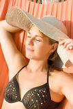 Pretty woman lying in a hammock Royalty Free Stock Photo
