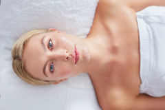 Pretty woman lying on massage table at dayspa Royalty Free Stock Photo